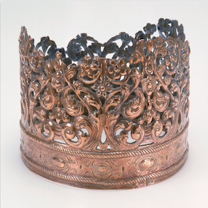 """Torah Crow, 1698-99, Bolzano, Italy (The Jewish Museum, New York) """"Originally dedicated to an Italian synagogue in 1698/99, this crown was later plundered during a Russian pogrom and then recovered. It became part of the collection of the Great Synagogue of Danzig in the early 20th century. In 1939, it was sent to the Jewish Theological seminary in New York for safekeeping when the Nazis' rise to power forced the Danzig Jewish community to disband."""" Source"""