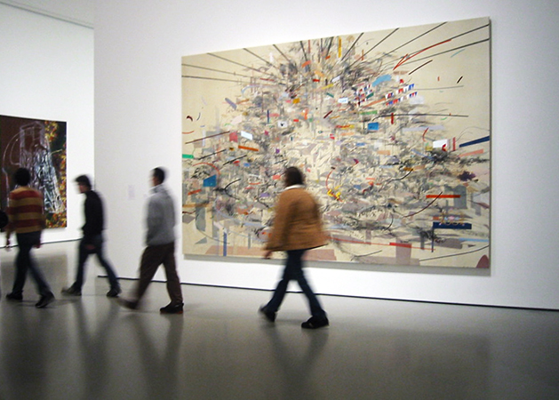 Visitors at The Museum of Modern Art in front of Julie Mehretu, Empirical Construction, Istanbul, 2003, ink and synthetic polymer paint on canvas, 10' x 15' (304.8 x 457.2 cm). Photo: thatgirl