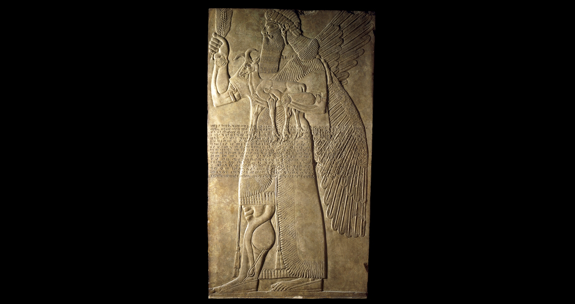Protective spirit, Stone relief from the North-West Palace of Ashurnasirpal II, Nimrud (ancient Kalhu), northern Iraq, Neo-Assyrian, 883-859 B.C.E., alabaster, 224 x 127 x 12 cm (extant) © Trustees of the British Museum  One of a pair which guarded an entrance into the private apartments of Ashurnasirpal II. The figure of a man with wings may be the supernatural creature called an apkallu in cuneiform texts. He wears a tasselled kilt and a fringed and embroidered robe. His curled moustache, long hair and beard are typical of figures of this date. Across the body runs Ashurnasirpal's 'Standard Inscription', which records some of the king's titles.