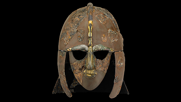 The Sutton Hoo helmet, early 7th century, iron and tinned copper alloy helmet, consisting of many pieces of iron, now built into a reconstruction, 31.8 x 21.5 cm (as restored) (The  British Museum)