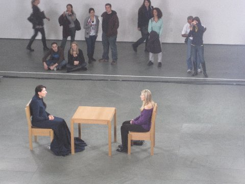 Marina Abramović sitting with Rebecca Taylor at The Artist is Present performance at The Museum of Modern Art, 2010